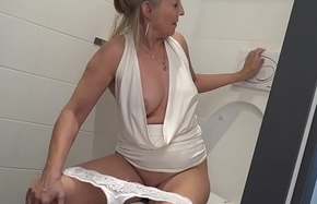 Blonde granny puts toilet scrub up young boys asshole